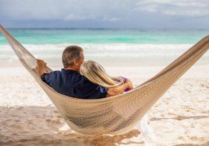 Man and woman sitting in hammock
