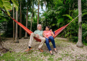 Couple sitting on a hammock