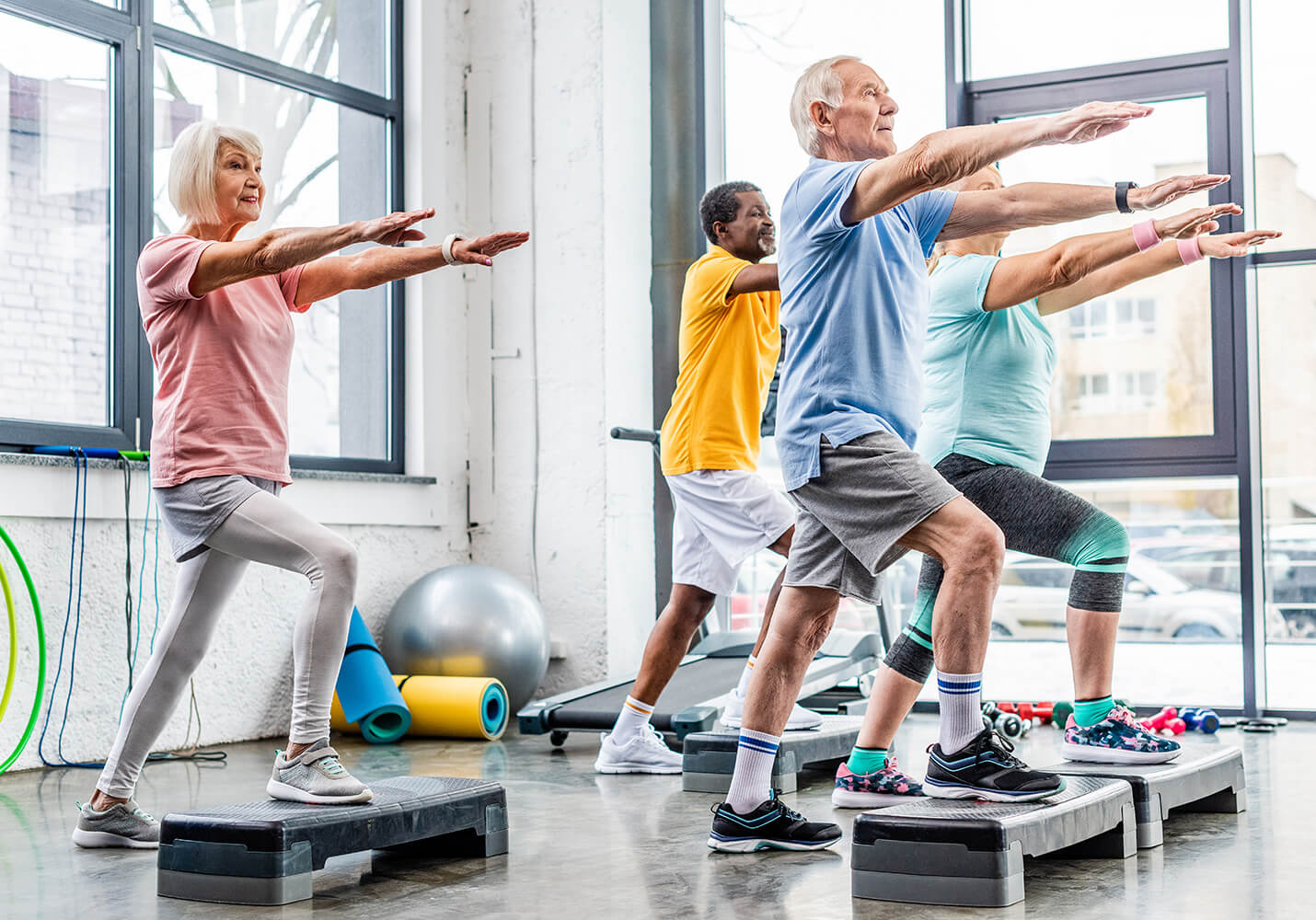 Senior citizens in exercise class