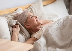 Woman waking up after restful sleep
