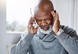 Man experiencing a headache