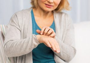 Woman itching hand