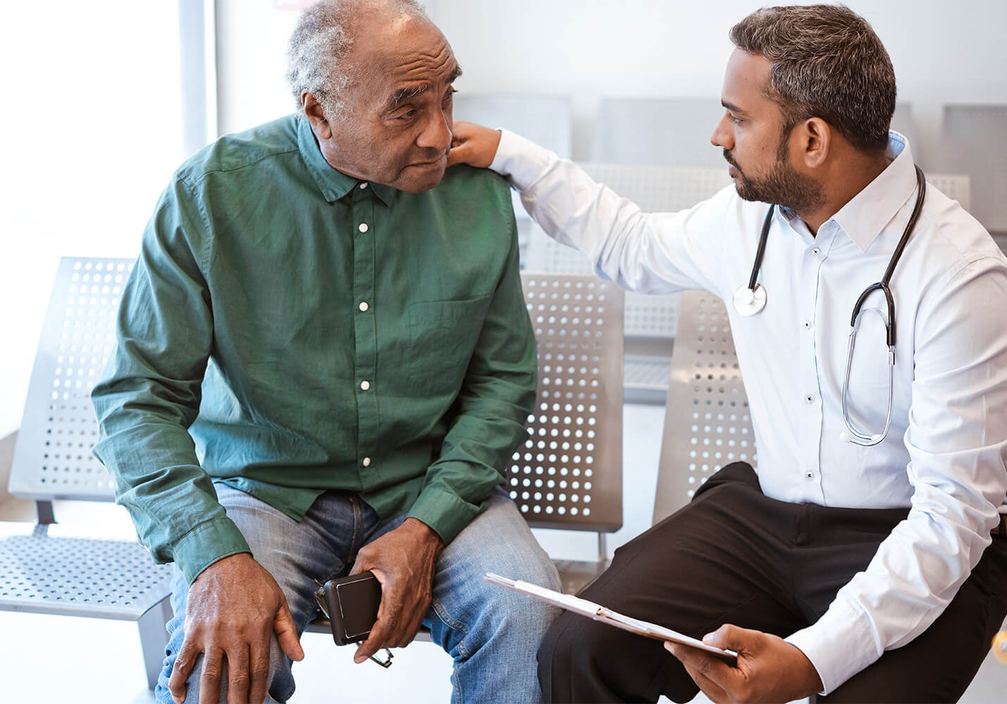 Older male patient with doctor