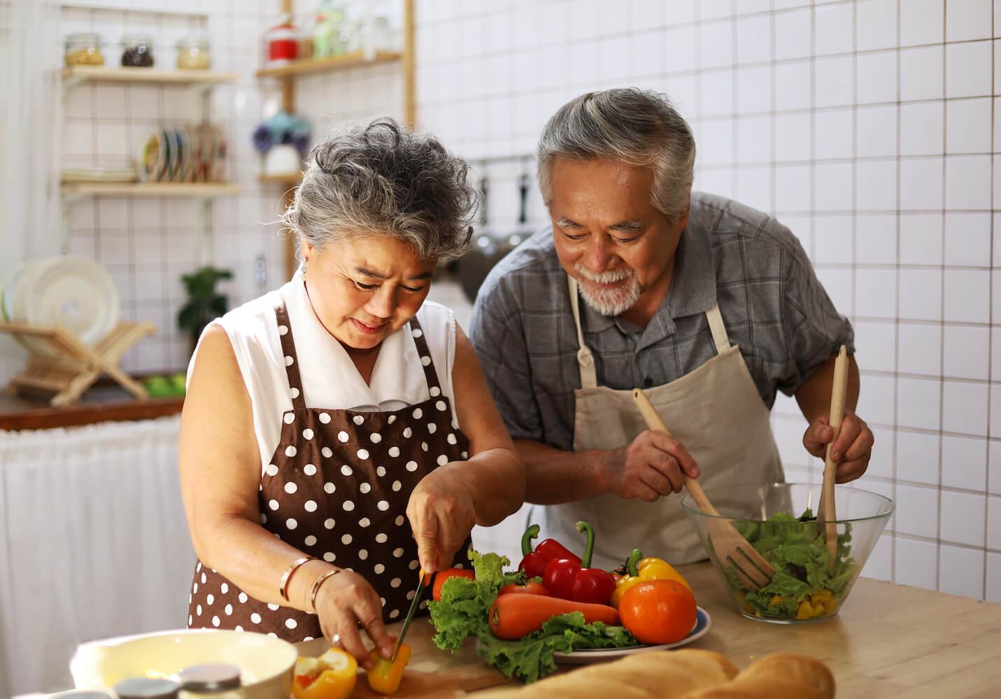 Senior couple preparing a healthy meal