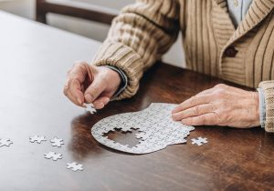 Man completing a puzzle